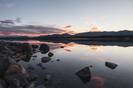 Sonnenuntergang am Lake Pukaki mit Blick auf Aoraki / Mount Cook
